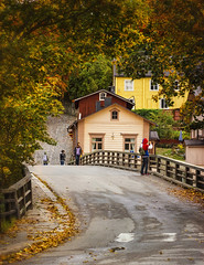 Going up (Jukka75) Tags: street old bridge autumn orange man building tree finland town photo leaf porvoo siver