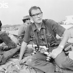 Saigon 10 May 1968 - British combat photographer Larry Burrows sits with Vietnamese soldiers during the second offensive on Saigon in the Vietnam War- Image by © Christian Simonpietri/Sygma/Corbis thumbnail
