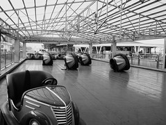 Bump Cars (GlindoJS) Tags: blackandwhite bumpcars sonynex sonynex5t