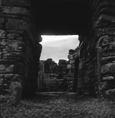 Broch of Gurness, Mainland Orkney (David Stumpp |[o]| Photography) Tags: road street uk greatbritain light people bw white podcast black 120 6x6 tlr film monochrome rolleiflex zeiss photoshop square photography islands daylight site orkney focus day natural unitedkingdom tmax country human carl fields epson farms medium format mf manual grayscale 80 35 archeology dig interest anthropology available mainland archeological nationalgeographic villiage planar twinlensreflex ironage 75mm kodaktmax homedeveloped fpp creativesuite 35f v500 anthropological brochofgurness cs6 photoscanner rolleiretro80s filmphotographyproject