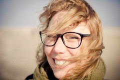 Woman Sarah (VenhuizenM) Tags: red sea woman cute netherlands smile lady hair 50mm glasses teeth hague photograph f18 the d3100 vision:outdoor=0619