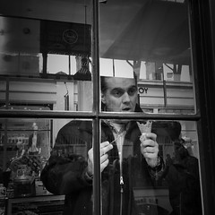 Harold realised that he hated rum and raisin (Rob Pearson-Wright) Tags: street uk blackandwhite bw london ice candid cream streetphotography streetlife coventgarden iphone