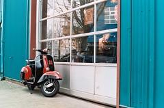 Vespa (Yutaka Seki) Tags: canada film 35mm canon 50mm lomography saturated vespa market ae1 wheels scooter analogue vancouverbc granvillemarket fd50mmf14 lomography800