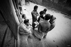 Sharing the morning news (jr) Tags: world life street old winter people news reading newspaper community candid group culture sharing ritual dhaka simple oldtown bangladesh armanitola