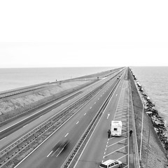 road to nowhere (timmytimtim75) Tags: road street sea bw cars netherlands monochrome square ijsselmeer afsluitdijk