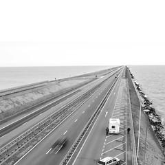 road to nowhere (timmytimtim75) Tags: road street sea bw cars netherlands monochrome square ijsselmeer afsluitdijk