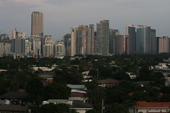 Manila from a 13th floor in the red light district (christbt) Tags: dusk philippines ciudades manila vistas cristal highrises anochecer rascacielos glassbuildings megaciudades frommakatiredlightdistrict