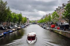 Amsterdam (Alberto Grego Photography ) Tags: city sky cloud flower tree amsterdam alberi river landscape boat europa nuvole cielo rivers fiori viaggio paesaggio olanda citt holand tulipani fiumi bartca