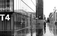 While waiting for the opening (pascalcolin1) Tags: blackandwhite reflection rain noiretblanc pluie bnf reflets streetview paris13 photoderue urbanarte photopascalcolin