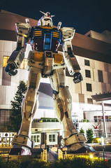 He Stands Alone... (NOAC_) Tags: lighting city travel light urban anime color colour travelling tourism statue japan night outside japanese lights tokyo colorful nightly cityscape pentax outdoor famous sightseeing vivid landmark tourist traveller faded odaiba colourful traveling split tokyoite gundam toned k5 traveler iis toning rx782 cityfront pentaxian