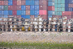 Containers and cable reels (G. Warrink) Tags: boat rotterdam ship harbour transport cargo