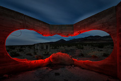 portal. carrara, nv. 2016. (eyetwist) Tags: longexposure windows shadow red sky usa plant lightpainting mountains west building abandoned geometric architecture night clouds rural dark landscape concrete photography star nikon ruins long exposure factory shadows desert decay empty nevada cement ruin trails wideangle fullmoon nv dirt american edge highdesert works vista flashlight americana deathvalley lonely portal walls nikkor desolate derelict nocturne beatty carrara startrails typology mojavedesert wasteland urbex foundations us95 rimlight elizalde eyetwist npy 1024mm d7000 capturenx2 eyetwistkevinballuff nikond7000 1024mmf3545g americantypologies