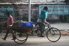 Grow your own tail (N A Y E E M) Tags: rickshawvan pedestrian morning winter light street norahmedroad chittagong bangladesh sooc windshield