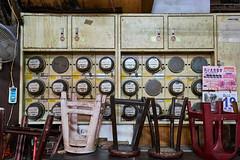 Dials and Chairs (gullevek) Tags: wall chair fuji market taiwan dial taichung meter tw     utilitymeter taichungcity fujixt1 fujinonxf1855mmf28f4rlmois