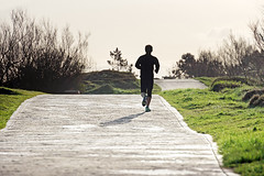 silhouette of person jogging (Mimadeo) Tags: road park sunset shadow silhouette sport training person healthy exercise outdoor path walk lifestyle running run health activity jogging fitness runner jog jogger active getxo vitality