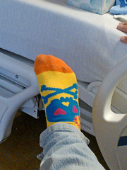 On the Side of the Hospital Bed (BKHagar *Kim*) Tags: blue red orange yellow hospital foot skull al bed sock heart alabama huntsvillehospital bkhagar