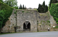 A Lower Entrance into Volterra, Italy (Crumblin Down) Tags: plaza rome green tower classic church stone town ancient ruins theater arch theatre roman basilica seat hill volterra entrance medieval cobble cobblestone column piazza seating vampires etruscan hilltown tuscana volturi