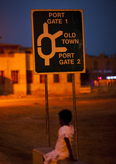Kid Standing Below A Road Sign, Massawa, Eritrea (Eric Lafforgue) Tags: africa road people vertical night outdoors women oneperson onepeople massawa eritrea hornofafrica realpeople eritreo erytrea eritreia colourimage 1people  massaoua ertra    eritre eritreja eritria unrecognizableperson  rythre africaorientaleitaliana     eritre eritrja  eritreya  erythraa erytreja     ert7179