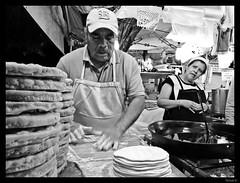 255/365 Haciendo buñuelos (nan_ita) Tags: people blackandwhite blancoynegro cooking gente dough streetphotography 365 masa buñuelos originalphotography fotografíacallejera photographersontumblr