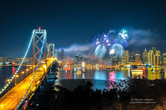Happy New Year 2014 (Darvin Atkeson) Tags: show sanfrancisco new eve skyline landscape island bay coast pier cityscape treasureisland pacific suspension fireworks 14 baybridge embarcadero years yerbabuena portofsanfrancisco 2014 darvin 2013 atkeson darv liquidmoonlightcom baylights