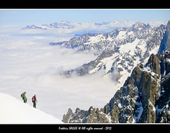 France - Trekking Style around Aiguille du Midi (3842 m.) (Frdric Salle) Tags: voyage travel light italy cloud sun mountain ski alps color colour rock montagne alpes trekking trek canon switzerland climb soleil skiing suisse lumire rocky climbing nuage chamonix italie montblanc alpinisme escalade aiguilledumidi hautesavoie eos400d