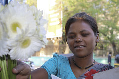 Flower Seller (Chesil) Tags: street travel portrait people woman india flower girl female young maharashtra seller pune chesil