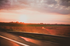 on my way to france (JESUS  YOU) Tags: road street blue trees light sunset red summer sky cloud sun blur paris france tree green nature yellow clouds canon landscape movement blurry highway europe cloudy bokeh frana lensflare flare nuvens 1855mm canont3 canoneos1100d canon1100d vision:sunset=097 vision:sky=0912 vision:clouds=0856