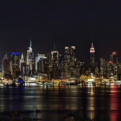 The Big Apple (Subversive Photography) Tags: city nyc longexposure usa newyork reflection skyline night america skyscraper square lights us newjersey cityscape manhattan squareformat chryslerbuilding canon5dmarkii
