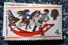 Christmas Stamp (chrisw09) Tags: christmas boy red horse hot stockings girl hair fun shoes play boots head stamps candid tights skirt queen stamp jeans jumper rocking bows rockinghorse saddle mane bridle reins