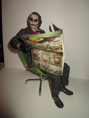 Joker Reading Sunday Funnies - Comic Strips 8984 (Brechtbug) Tags: new york city nyc red portrait man hot male men green film mystery comics neck movie private toy toys reading book avocado weird newspaper blood chair 60s uniform gun comic with serious action sunday egg tie funnies super plastic disguise heath hero figure 70s joker why 1960s 1970s gotham villain figures strips 1960 investigator 2014 ledger cowl so 05052014