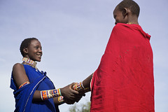 Maasai girls holding hands, Kajiado area, South Kenya (Alex_Saurel) Tags: africa travel vacation portrait people woman playing color cute girl beautiful beauty smile smiling female pose necklace couple pretty day outdoor african femme traditional group scenic culture photojournalism posing bijou clothes portraiture laugh tradition fullframe fille sourire 50mmf14 reportage afrique africans tunic beaute mignonne portray halfbody souriant photoreport photoreportage pleinformat estethique shuka