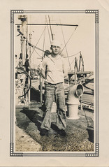 Sailor poses on the deck of a ship (simpleinsomnia) Tags: old shadow white man black monochrome hat vintage found boat blackwhite ship antique snapshot posed posing photograph vernacular sailor foundphotograph