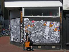 streets of brighton (maximorgana) Tags: street orange streetart art window bike shop bag walking duck brighton dirty derelict tote trashbit