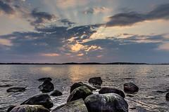 Beautiful Sunset (nureco) Tags: denmark sky lake sea sunset water beach travel stones blue sun sunlight light clouds ocean summer beautiful roskilde frederikssund visitroskilde nureco roskildefjord