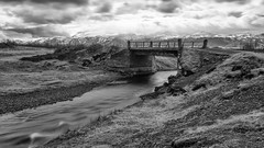 When all is peaceful and still (OR_U) Tags: longexposure bridge blackandwhite bw snow ice monochrome clouds river concrete volcano blackwhite iceland spring movement widescreen may le oru schwarzweiss 169 2016 eyjafjallajkull mpountain merkjriver