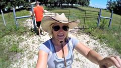 Heading Out (The Wild Roam Free) Tags: neon texas cowboyhat aviators texans sunscreen bighat blondewoman