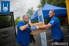 IRUSA volunteers take out the Ramadan food boxes from the truck at the ADAMS center food distribution in Virginia.