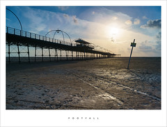 Footfall (Parallax Corporation) Tags: sunset sky beach silhouette clouds warning evening pier seaside sand mud structure southport