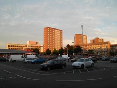 tesco car park with trelawney estate e9 behind, 2016-06-22_20-57-26 (tributory) Tags: blue sunset summer sky brown brick london weather retail architecture contrast buildings shopping walking concrete evening horizon transport pedestrian vehicles hackney care carpark e9 colourcontrast