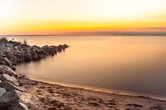 Deal Island Jetty at Sunser (Robchaos) Tags: ocean longexposure sunset sea beach water beautiful landscape island coast sand nikon colorful dusk jetty shoreline maryland easternshore shore somersetcounty ndfilter dealisland colorfulsunset tokina288028 d700