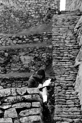 Girl noting at Machu Picchu (Javier A Bedrina) Tags: street old city travel people mountain building tourism peru girl machu picchu inca cuzco america writing poster person town indian cusco south traditional decoration culture historic exotic american andes learning civilization concept peruvian sudamerica bedrina