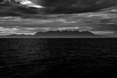Crowning glory..... (Dafydd Penguin) Tags: skye cuillin cuillins mountain range scotland scottish hill munroe silhouette clouds blackandwhite blackwhite black white bw monochrome sunlight coastal coast cruising sailing sialboat nikon d600 nikkor 50mm af f14d