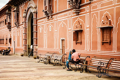 Couple at City Palace, Jaipur, India (Seven Seconds Before Sunrise) Tags: travel people woman india man bench couple asia jaipur rajasthan citypalace pinkcity southasia