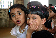 Oh! A camera! (gornabanja) Tags: girls portrait india smile face nikon funny d70 expression kerala laughter