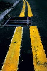 Curb appeal (39:52) (HartwellPhotography.co.uk) Tags: lines tarmac yellow grate doom curb doubleyellowlines roadmarkings
