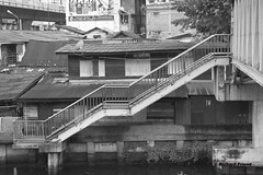 Steps and Roofs, Bangkok (Rich Friend) Tags: city urban blackandwhite monochrome lines stairs buildings thailand mono asia seasia cityscape bangkok steps angles everyday siam everydaylife urbandevelopment urbanspace cityspace urbanasia blackwhitephotos bangkokstreet phrakhanong canoneos7d canon7d