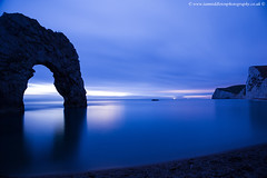 Durdle Door at Dusk (Ian Middleton: Photography) Tags: world ocean county door old uk blue sea vacation england holiday seascape english heritage history tourism beach water rock stone landscape evening coast site seaside amazing ancient rocks arch view britain dusk south united famous sightseeing kingdom visit pebbles location tourist historic resort unesco formation southern national dorset trust stunning coastline british visitors jurassic channel sights attraction waterscape durdle
