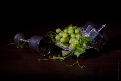 Grapes (BronwynKatzke) Tags: stilllife green silver 50mm vine bowl bunch lowkey pewter grapevine wealth chalice vanitas goblet grap niftyfifty