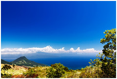 Camiguin View (4th Life Photography) Tags: travel blue sea vacation sky panorama nature sunshine clouds landscape island volcano asia horizon philippines palmtrees shore tropical camiguin cloudscape