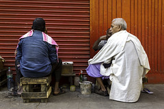The Colors of Kolkata (Vilvesh) Tags: street red people india colors canon photography barbershop kolkata cwc chennaiweekendclickers
